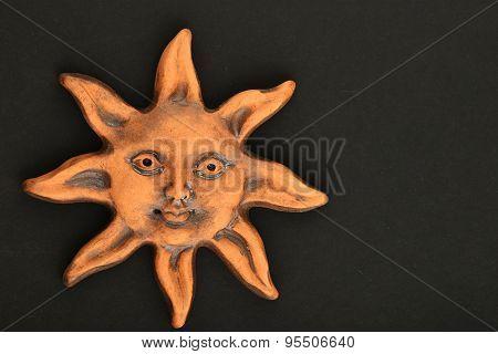 Smiling Glazed Ceramic Sun Souvenir Isolated On White