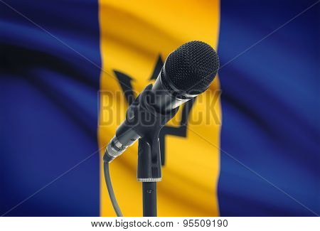 Microphone On Stand With National Flag On Background - Barbados