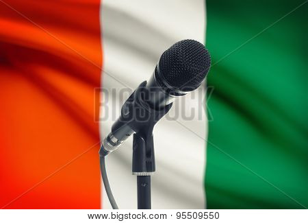 Microphone On Stand With National Flag On Background - Ivory Coast