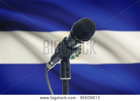 Microphone On Stand With National Flag On Background - El Salvador