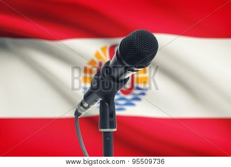Microphone On Stand With National Flag On Background - French Polynesia