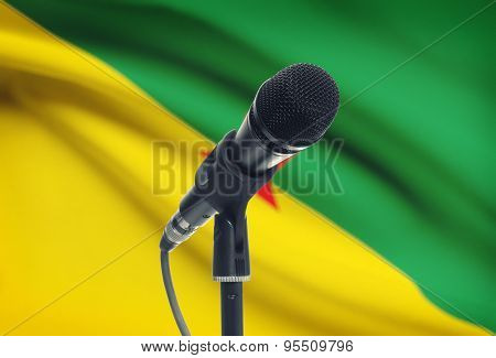 Microphone On Stand With National Flag On Background - French Guiana