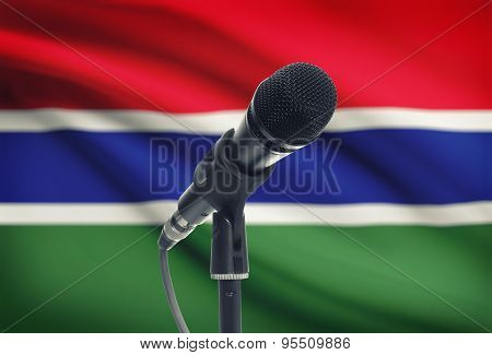 Microphone On Stand With National Flag On Background - Gambia