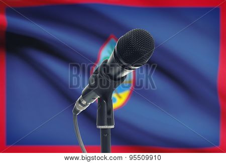 Microphone On Stand With National Flag On Background - Guam