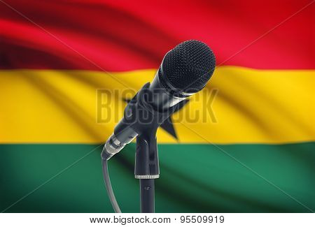 Microphone On Stand With National Flag On Background - Ghana