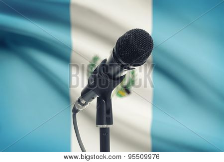 Microphone On Stand With National Flag On Background - Guatemala