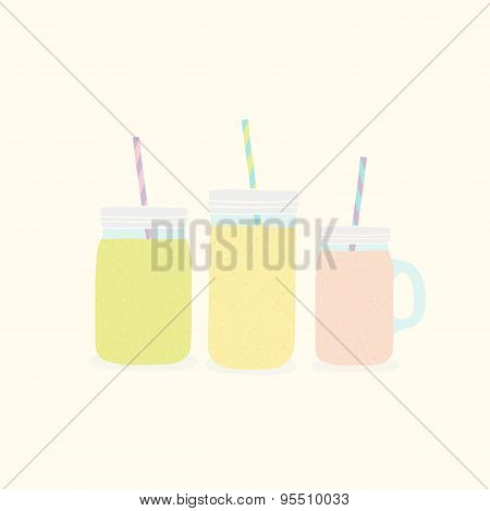 Three different mason jars with smoothies.