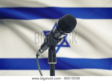 Microphone On Stand With National Flag On Background - Israel