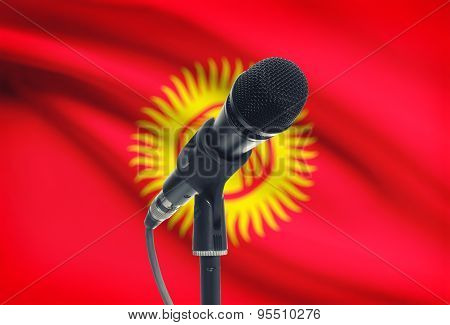 Microphone On Stand With National Flag On Background - Kyrgyzstan