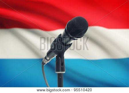 Microphone On Stand With National Flag On Background - Luxembourg