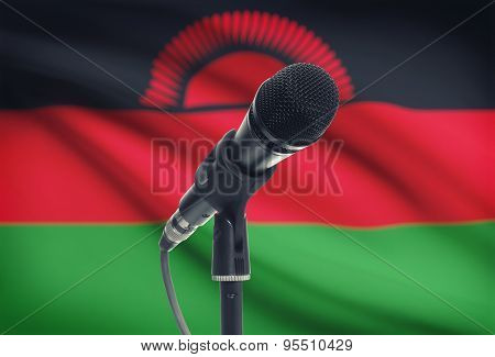 Microphone On Stand With National Flag On Background - Malawi