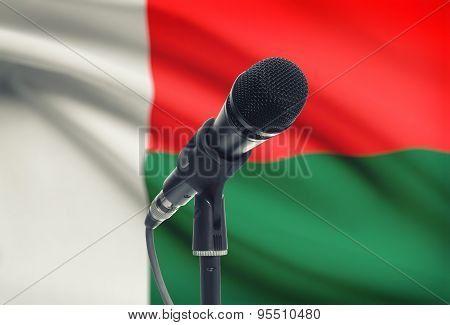 Microphone On Stand With National Flag On Background - Madagascar