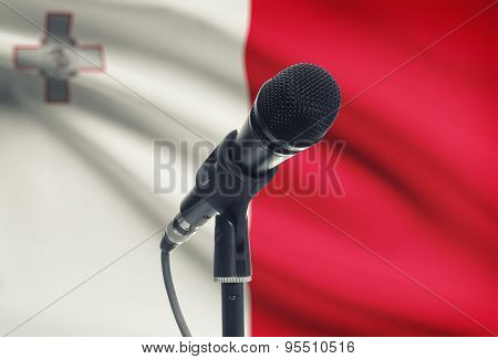 Microphone On Stand With National Flag On Background - Malta