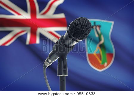 Microphone On Stand With National Flag On Background - Montserrat