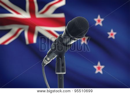 Microphone On Stand With National Flag On Background - New Zealand