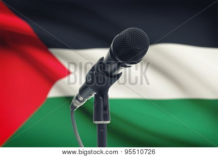 Microphone On Stand With National Flag On Background - Palestine