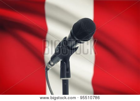 Microphone On Stand With National Flag On Background - Peru