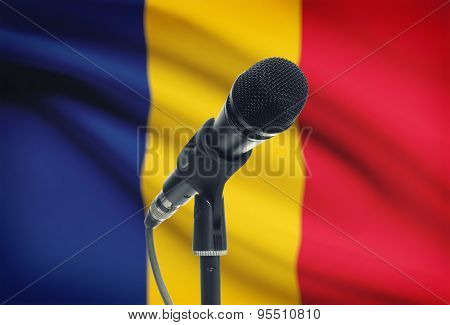 Microphone On Stand With National Flag On Background - Romania