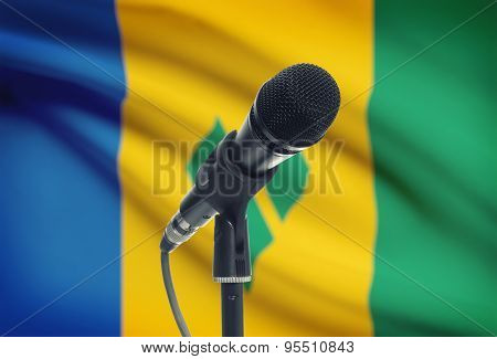 Microphone On Stand With National Flag On Background - Saint Vincent And The Grenadines