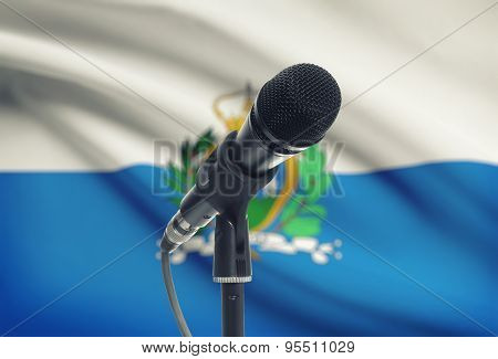 Microphone On Stand With National Flag On Background - San Marino