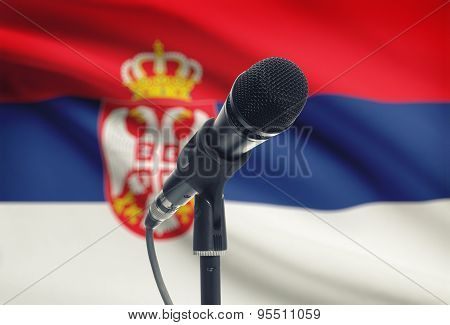 Microphone On Stand With National Flag On Background - Serbia