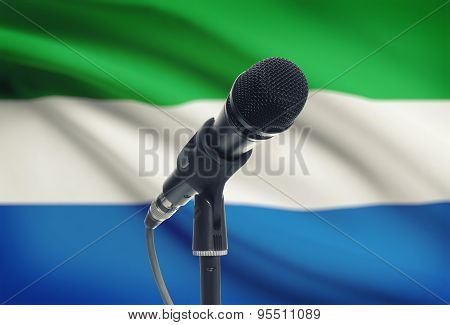 Microphone On Stand With National Flag On Background - Sierra Leone