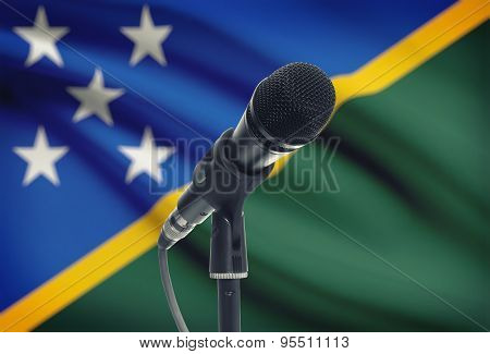 Microphone On Stand With National Flag On Background - Solomon Islands