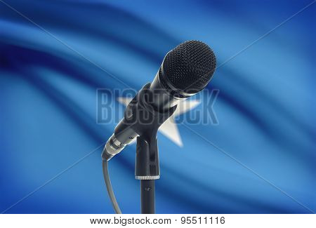 Microphone On Stand With National Flag On Background - Somalia
