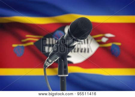 Microphone On Stand With National Flag On Background - Swaziland