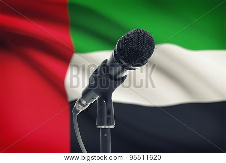 Microphone On Stand With National Flag On Background - United Arab Emirates