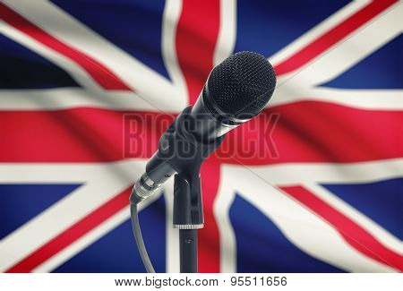 Microphone On Stand With National Flag On Background - United Kingdom
