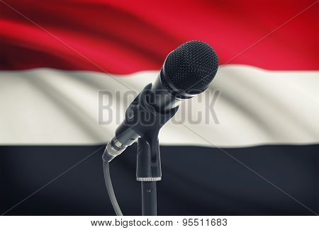 Microphone On Stand With National Flag On Background - Yemen