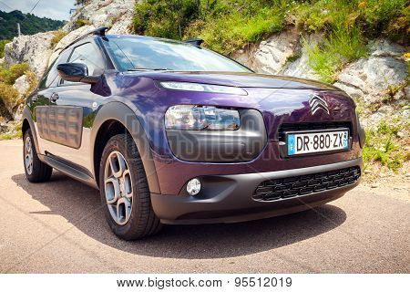 Purple Citroen C4 Cactus On The Mountain Road