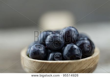 Fresh Blueberries In Spoon On Wooden Background, Close-up