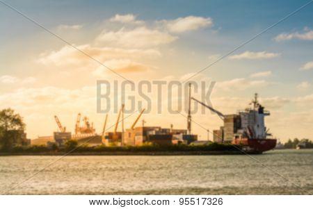 Blurred Cargo Ship In Sea Port