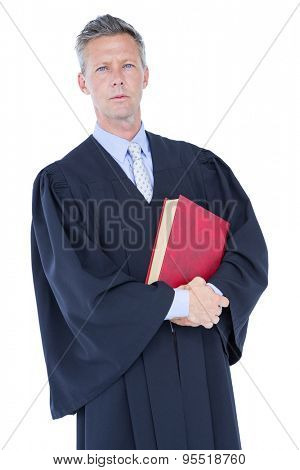 handsome lawyer holding labor code on white background