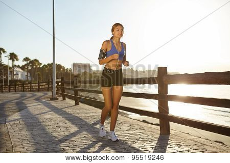 Young Athlete Jogging On The Beach Shore
