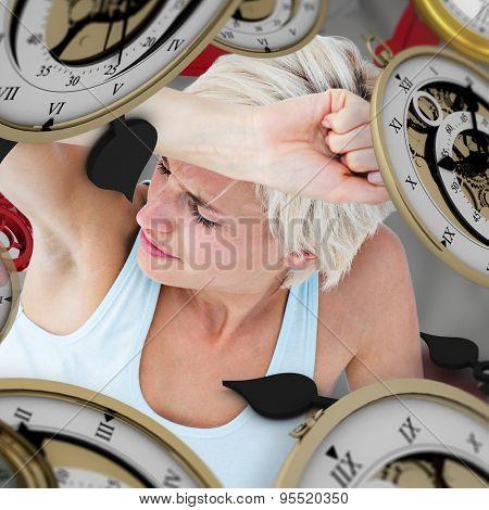 Depressed woman on the floor against grey vignette