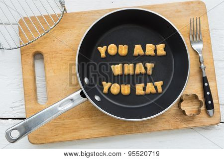 Letter Biscuits Quote You Are What You Eat And Cooking Equipments.