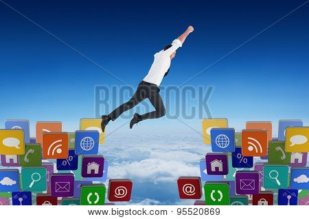 Flying businessman against blue sky over clouds at high altitude