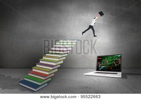 Businessman leaping with his briefcase against steps made from books in grey room