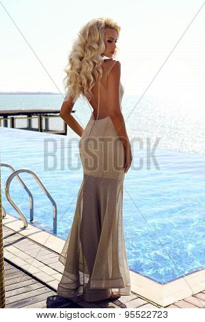 gorgeous sexy woman with blond hair in luxurious dress