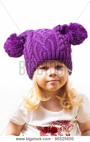 Nice little girl in knitted hat