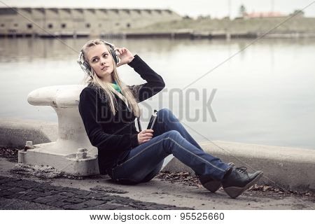 Girl with headphones and mobile phone