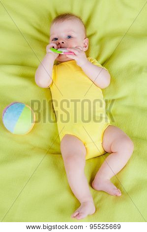 Little boy playing with  teether