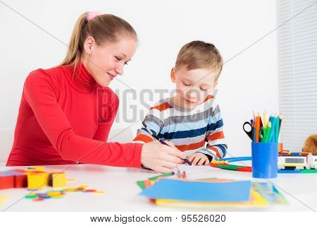 Preschooler child drawing with his mom