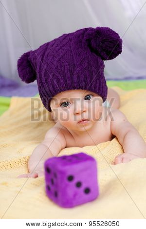Cute little boy looking to cube
