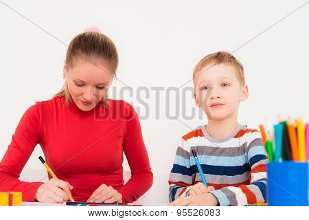 Son and mother drawing