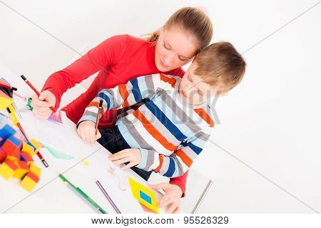 Son drawing with mother