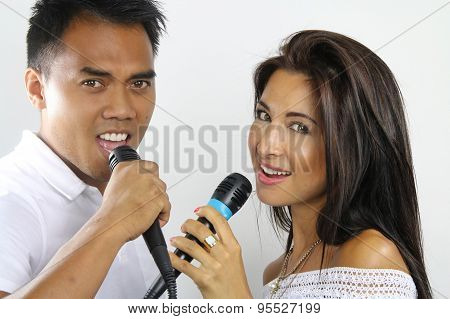 young couple making a Karaoke